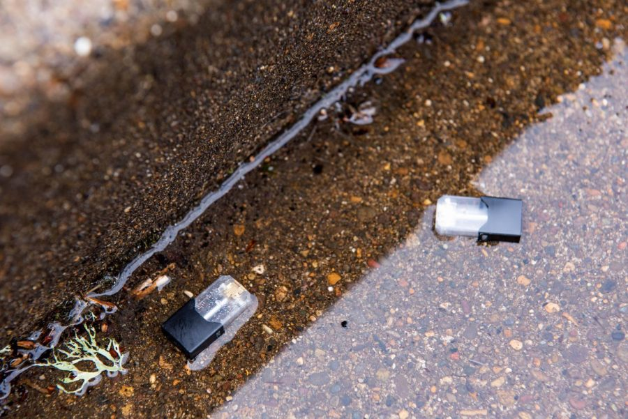 Discarded+Juul+pods+lie+on+the+ground.+Juul+is+a+popular+brand+of+electronic%C2%A0+cigarette