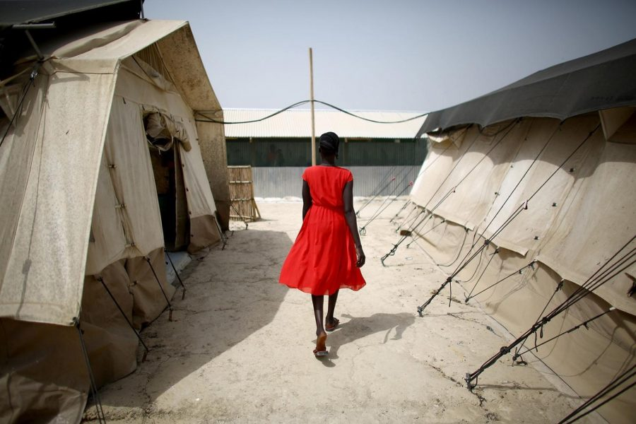 A+woman+walks+through+the+Medecins+Sans+Frontieres+%28Doctors+Without+Borders%29+field+hospital+compound+inside+the+United+Nations+Protection+of+Civilians+Site+near+Bentiu%2C+South+Sudan.+The+camp+is+home+to+more+than+120%2C000%2C+including+many+children+suffering+from+severe+malnutrition%2C+malaria%2C+tuberculosis+and+diarrhea.
