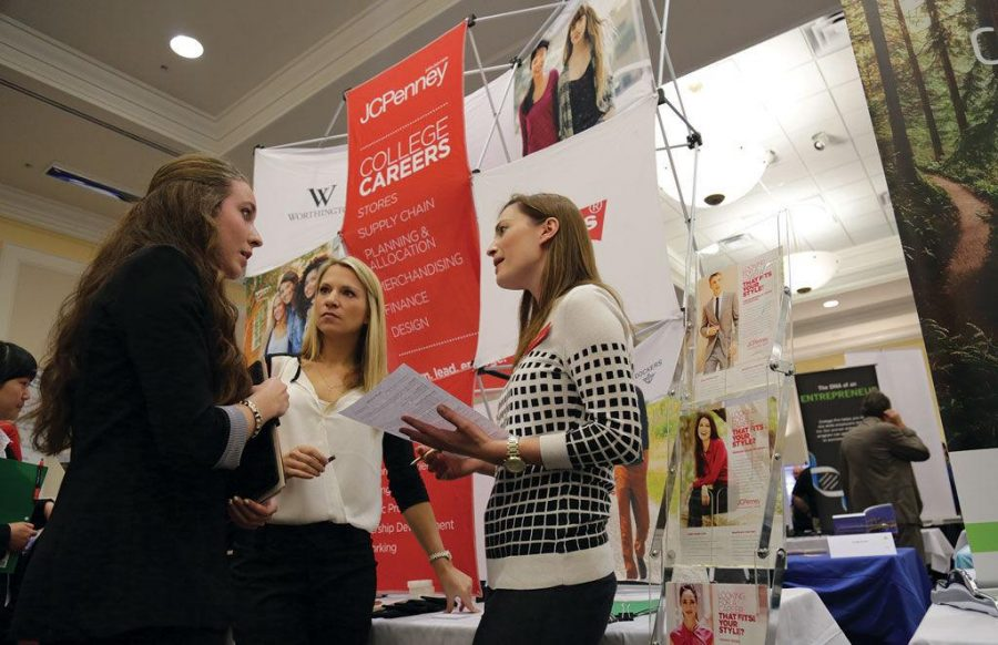 JCPenney+representatives+%28center%29+Molly+Clope+and+%28right%29+Brittany+Merritt+talk+to+junior+Lisa+Rosenthal+about+an+internship+opportunity+during+the+fall+2014+career+fair.%C2%A0