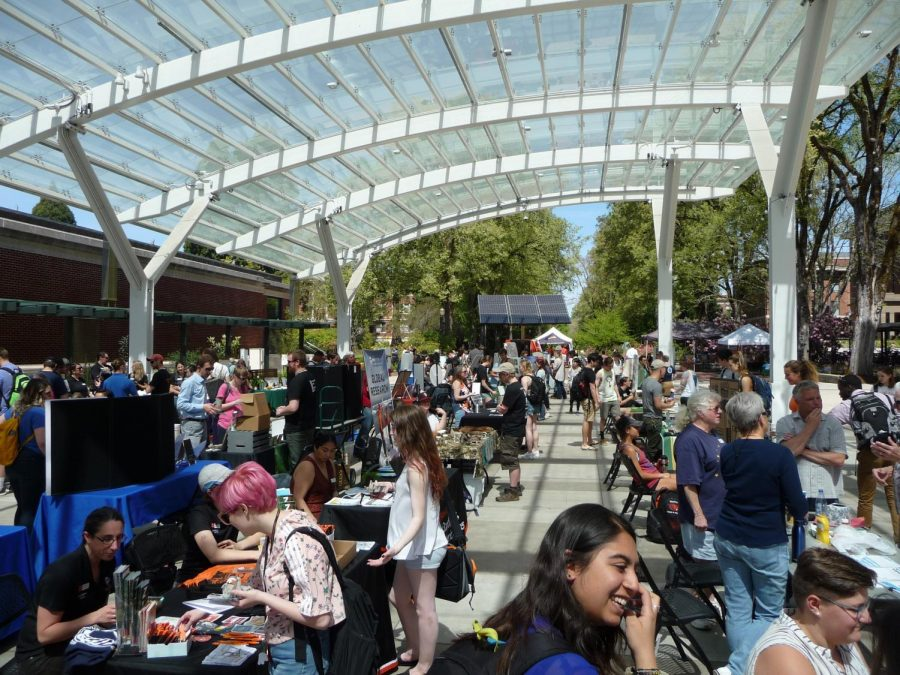 Community members peruse booths at the 2018 Beyond Earth Day Community Fair.