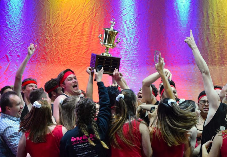 Alpha+Omicron+Pi+and+Sigma+Nu+hoist+up+their+trophy+after+winning+the+2019+All-University+SING+competition+on+May+3.