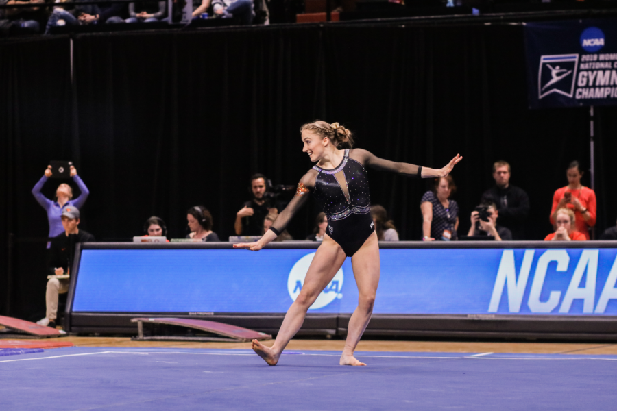 OSU+Gymnastics+senior+all-arounder+Mary+Jacobsen+strikes+a+pose+during+her+floor+routine+at+the+NCAA+Regional+meet+at+Gill+Coliseum.
