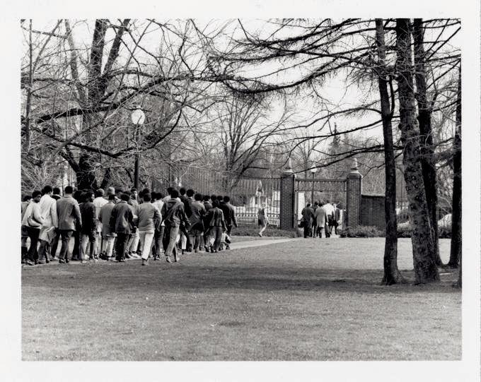 OSU's Black Student Union walks off campus near the campus gates.