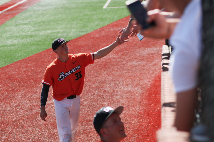 OSU+junior+catcher+Adley+Rutschman+extendes+a+fist+bump+to+fans+at+Goss+Satdium+after+Oregon+State%E2%80%99s+loss+to+Creighton.+Rutschman+has+been+projected+to+be+the+No.+1+pick+in+the+2019+MLB+Draft.
