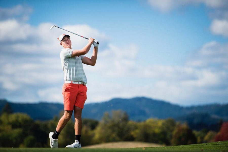 OSU Mens Golf member Spencer Tibbits,a second-year student at Oregon State University, swings towards the green.