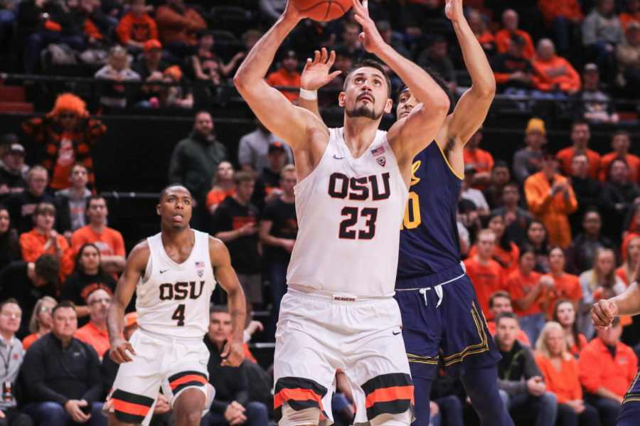 OSU Basketball senior center Gligorije Rakocevic goes for a lay-up against California in Gill Coliseum.
