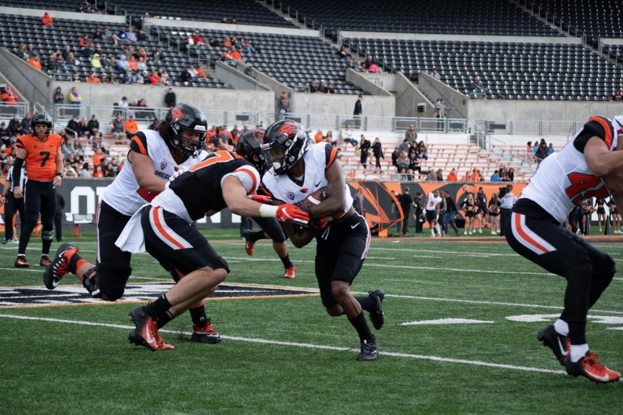 OSU Football offense fights for yard gains against the OSU Football defense at the Spring Preview Game in Reser Stadium on April 20.