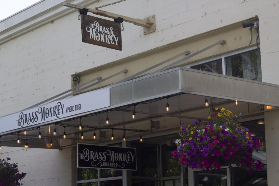 The Brass Monkeys storefront faces the waterfront in downtown Corvallis.
