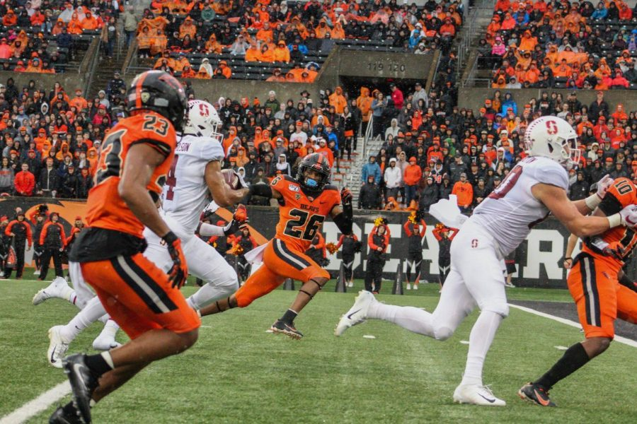 OSU+freshman+defensive+back+Jojo+Forest+keeps+pace+with+Stanford+junior+tight+end+Colby+Parkinson.%C2%A0