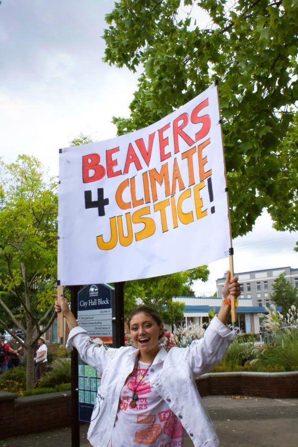 OSU student Jess Thompson holds up her sign at a climate rally on Sept. 20, 2019.