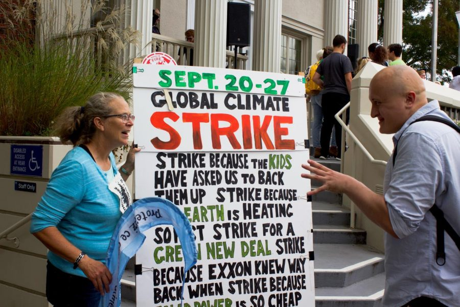 Corvallis High School teacher and Green Club advisor Julie Williams (left) speaks to another protester at a student-led march to City Hall as part of the global Youth Climate Strike back in September.