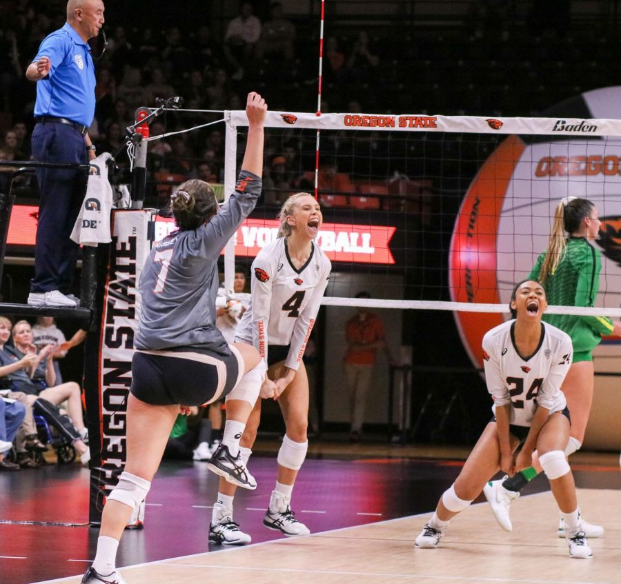 OSU Volleyball junior outside hitter Haylie Bennett (#4), senior middle blocker Serena Bruin (#24) and junior libero Grace Massey (#7) celebrate a point awarded by the referee.