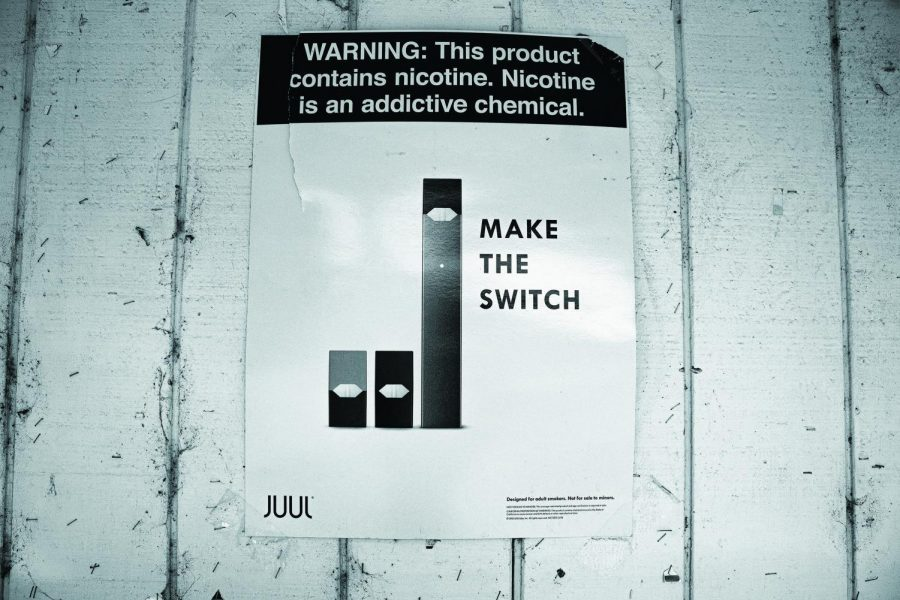 Juul+ads+are+displayed+outside+of+Western+Market%2C+which+lies+on+the+outskirts+of+the+OSU+campus.+Regardless+of+advertising%2C+the+rise+of+underage+vaping+has+increased.%C2%A0