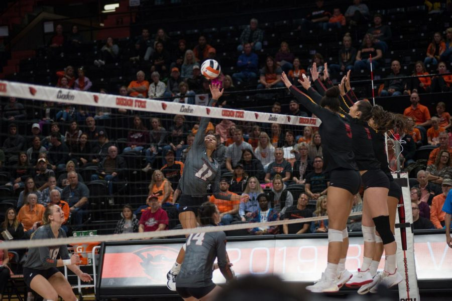 OSU sophomore outside hitter Chloe Brown spikes the ball over the net to the waiting USC defenders.