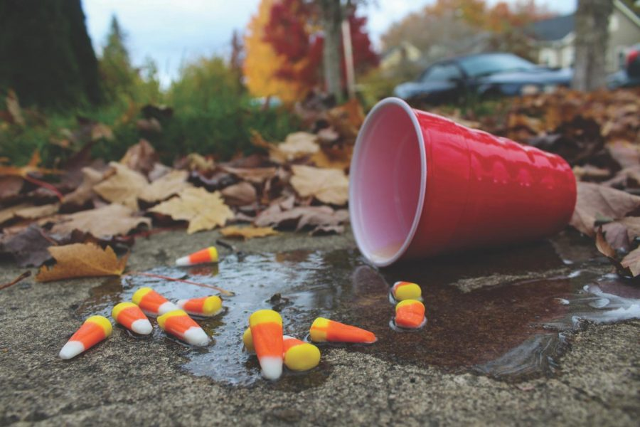 Candy+corn+lies+sprinkled+around+a+spilled+cup+of+liquid.+Drinking+occurs+at+some+Halloweekend+parties%2C+and+the+police+are+encouraging+students+to+make+smart+choices.%C2%A0