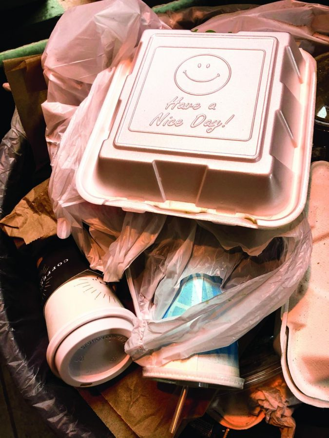 An+overflowing+garbage+can+outside+of+Shepard+Hall+is+filled+with+plastic+cups%2C+bags+and+takeaway+containers.