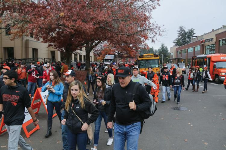 Students and their familes head toward Reser Stadium to watch the Fall Family Weekend football game.