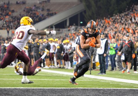 Redshirt senior tight end Noah Togiai evades a defender to reach the endzone in their matchup versus Arizona State on Nov. 16 for senior night in Reser Stadium.