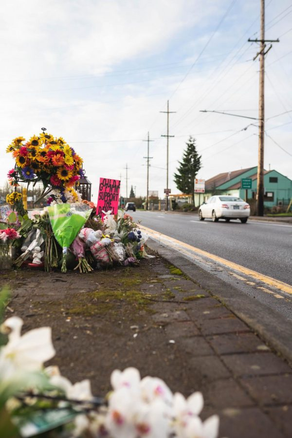 Flowers+left+at+the+memorial+to+an+11-year-old+girl+at+a+crosswalk+on+Highway+99%2FThird+Street+in+early+January.+This+death%2C+as+well+as+others+in+the+Corvallis+area+in+the+past+18+months%2C+have+prompted+community+members+to+call+on+the+city+government+and+the+state+of+Oregon+to+improve+crosswalk+safety+among+other+improvements.
