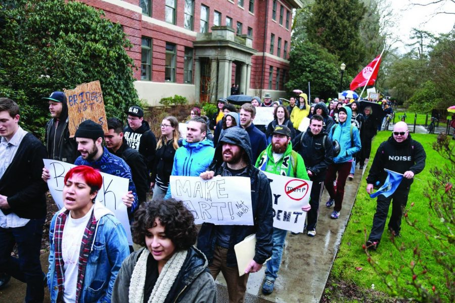 Students+and+community+members+make+their+way+through+campus+in+protest+of+the+election+of+Donald+Trump+in+January+2017.%C2%A0