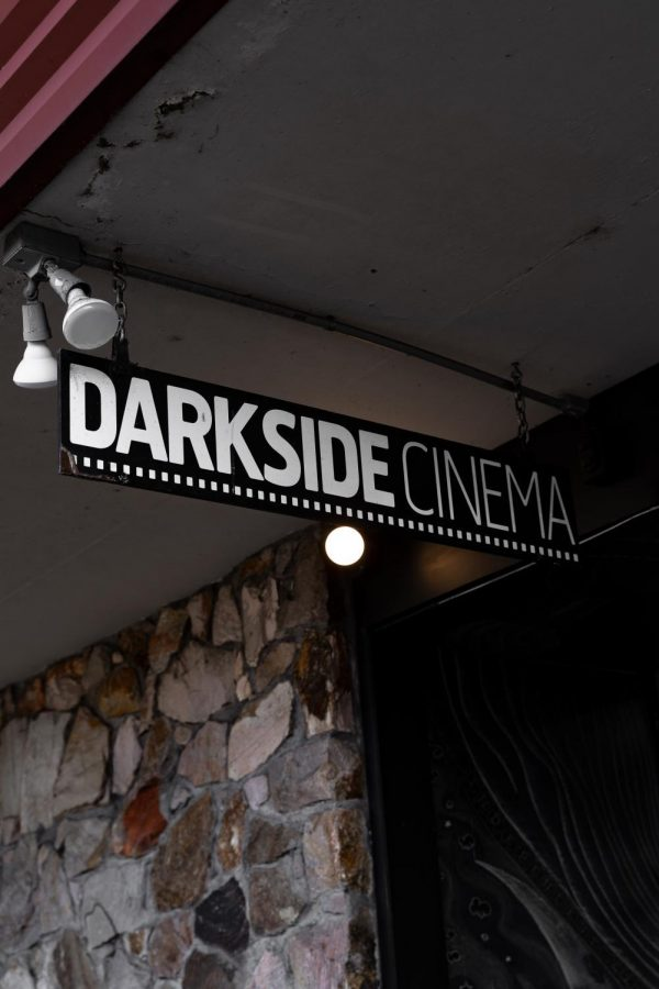 The+Darkside+Cinema+sign+hangs+above+the+main+entrance+of+the+theater.