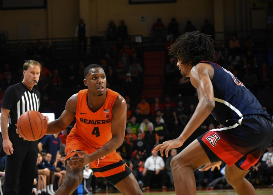 OSU+junior+forward+Alfred+Hollins+%28%234%29+works+to+find+space+around+an+Arizona+defender+in+Gill+Coliseum+on+Jan.+12.%C2%A0