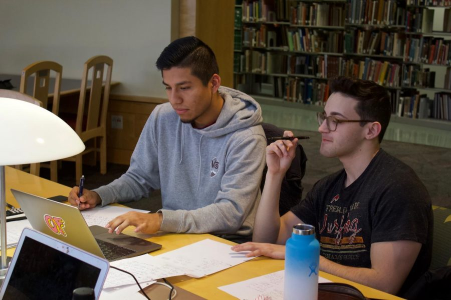 Juniors+Juan+Altamira+and+Sam+Aragon+study+in+the+Valley+Library+Rotunda+ahead+of+finals.+Many+students+come+to+study+here+for+the+view+and+to+study+in+between+classes.