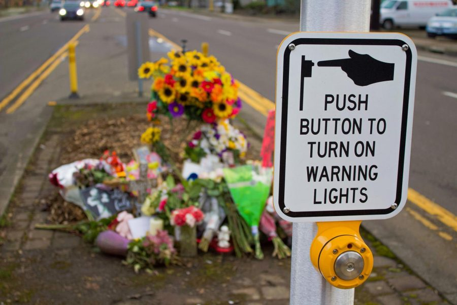 Flowers+and+signs+placed+around+the+crosswalk+on+SW+Third+Street+in+Corvallis+in+remembrance+of+an+11-year-old+who+was+fatally+hit+early+last+month.