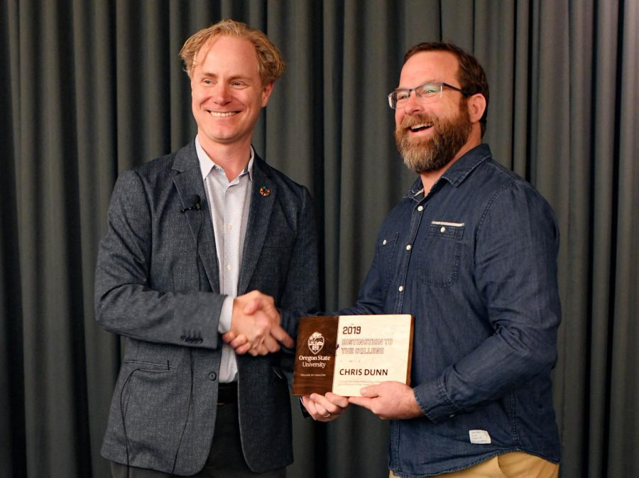 Postdoctoral+Research+Associate+Christopher+Dunn%2C+right%2C+shakes+hands+with+Interim+Dean+for+the+College+of+Forestry%2C+Anthony+S.+Davis+as+he+receives+the+Dean%E2%80%99s+Award+for+%E2%80%9CSpecial+Service+to+the+College+of+Forestry.%E2%80%9D+Dunn+received+this+award+for+his+efforts+with+Governor+Kate+Brown%E2%80%99s+Wildfire+Council+to+update+and+improve+fire+management+policies+and+procedures+at+OSU.