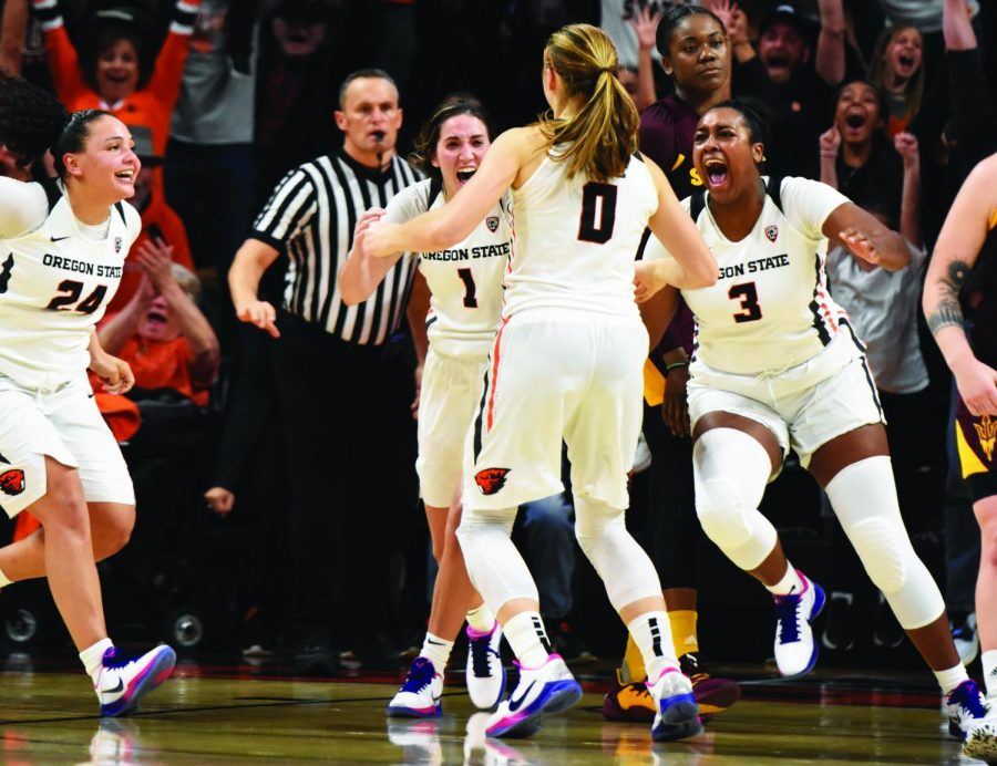 OSU teammates—junior guard Destiny Slocum (#24), junior guard Aleah Goodman (#1), senior guard Mikayla Pivec (#0), and senior guard/forward Madison Washington (#3)—run towards each other in celebration after Pivec shoots a buzzer-beater to win the game against ASU at Gill Coliseum, Friday, Feb. 7, 2020. After trailing by more than 10 points in the second quarter, OSU made an incredible comeback during the second half of the game.