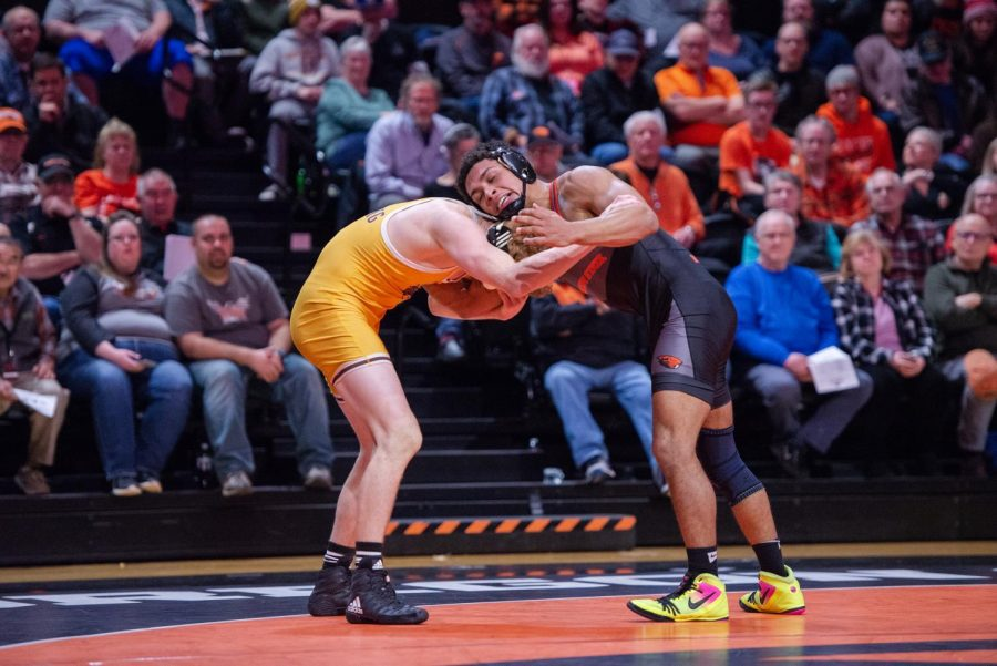 OSU redshirt junior Aaron Olmos battles against Wyoming redshirt freshman Cole Moody. Olmos secured the victory over Moody, one of Oregon State's total four for the match against Wyoming.