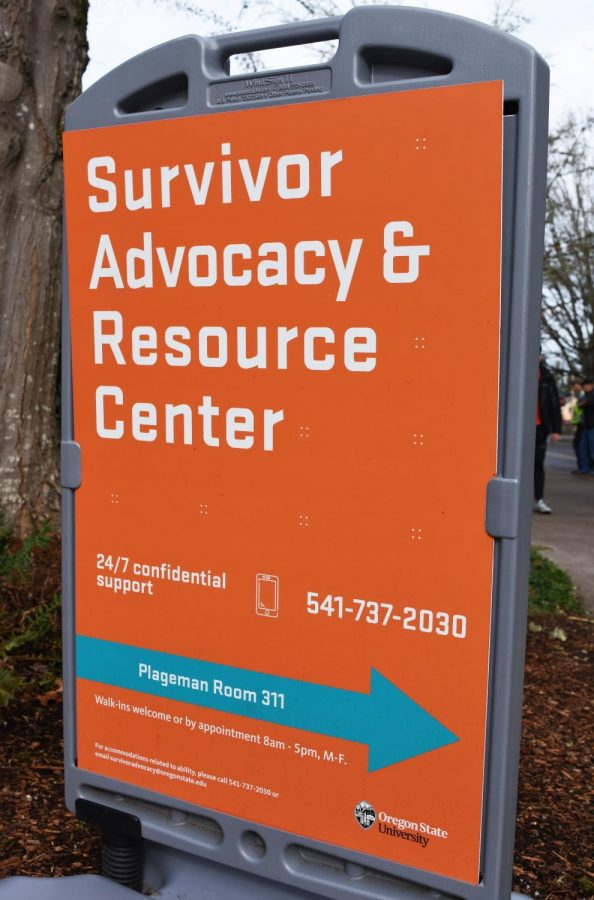 A sign promoting the Survivor Advocacy and Resource Center sits outside of the Plageman Student Health Center at Oregon State University, Thursday, Feb. 6, 2020.