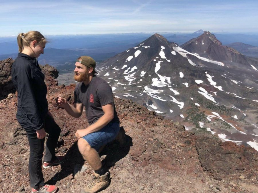 Brian+Engdahl+proposes+to+Katelyn+Ohlrich.+The+couple+has+been+together+since+Valentine%E2%80%99s+Day+in+2013+when+the+two+were+student-athletes+together+at+OSU.+The+pair+hiked+to+the+summit+of+South+Sister+Mountain+in+Bend%2C+Ore.+with+a+group+of+friends+before+Engdahl+surprised+Ohlrich+with+the+engagement.
