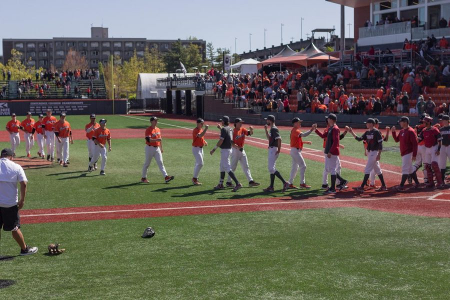 OSU+Baseball+exchanges+high+fives+after+a+game+versus+Washington+State+in+late+April+2019+in+Goss+Stadium.
