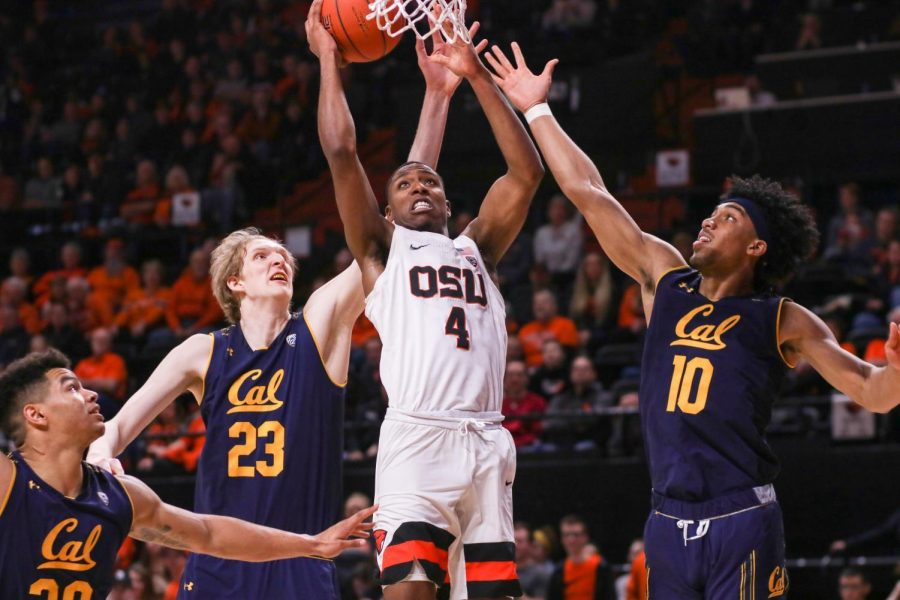 OSU+forward+Alfred+Hollins+%28%234%29+goes+up+for+a+shot+while+California+forwards+Connor+Vanover+%28%2323%29+and+Justice+Sueing+%28%2310%29+go+up+for+the+block+in+Gill+Coliseum+on+Feb.+9%2C+2019.+Hollins+scored+14+points+in+the+second+half+while+playing+at+California+on+Feb.+1%2C+2020.%C2%A0