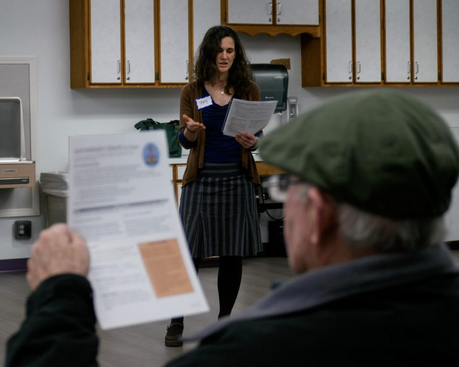 Corvallis Housing and Neighborhood Coordinator Tracy Oulman, center, explaining to community members like Mark Files, right, the benefits of applying for Empowerment Grants.