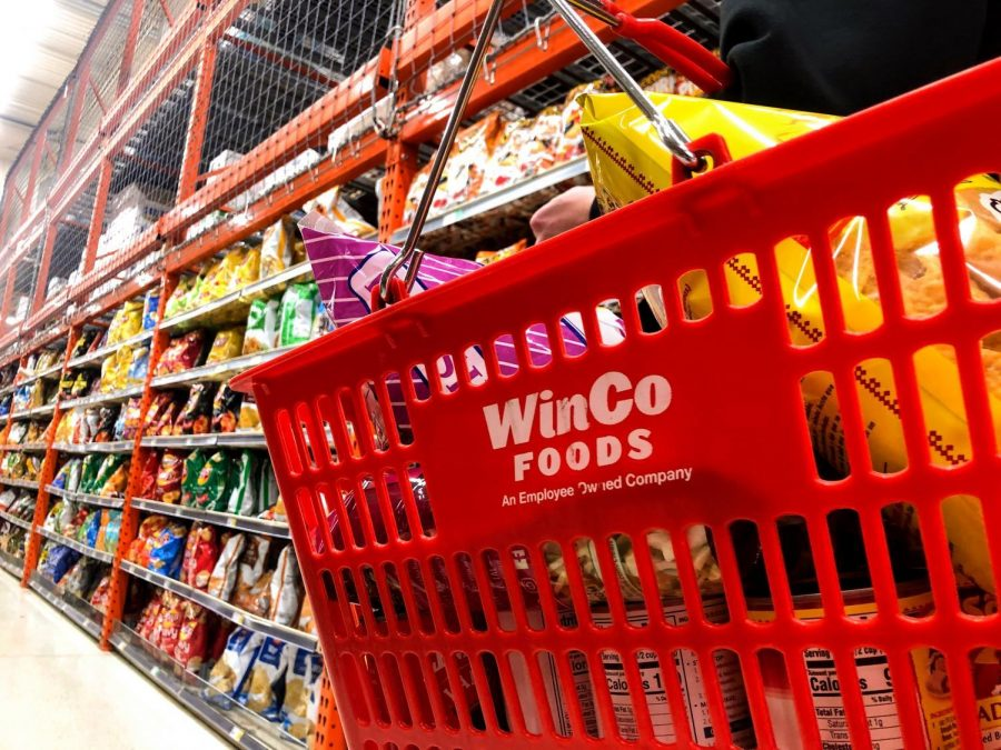 A+shopper%2C+carrying+a+basket+walks+down+the+chip+isle+of+Winco+on+Feb.+25.+Winco+is+a+popular+store+choice+for+Oregon+State+University+students+to+go+to+for+their+weekly+groceries.