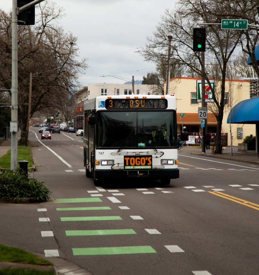 A+Corvallis+Public+Transit+bus+makes+it+way+down+Monroe+st.+The+citys+transit+service+is+free+to+ride.