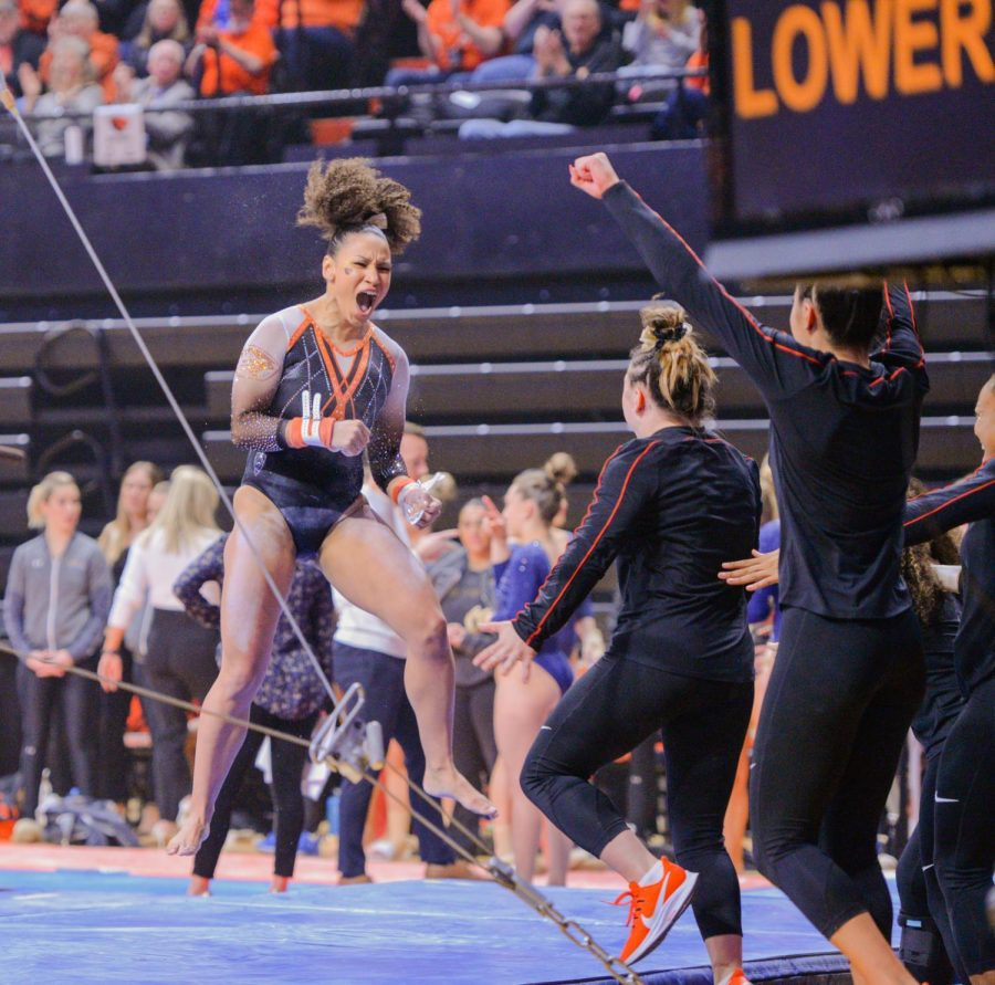 OSU+senior+Isis+Lowery+celebrates+after+her+uneven+bars+routine+during+meet+versus+UCLA+in+Gill+Coliseum+on+Feb.+29%2C+2020.