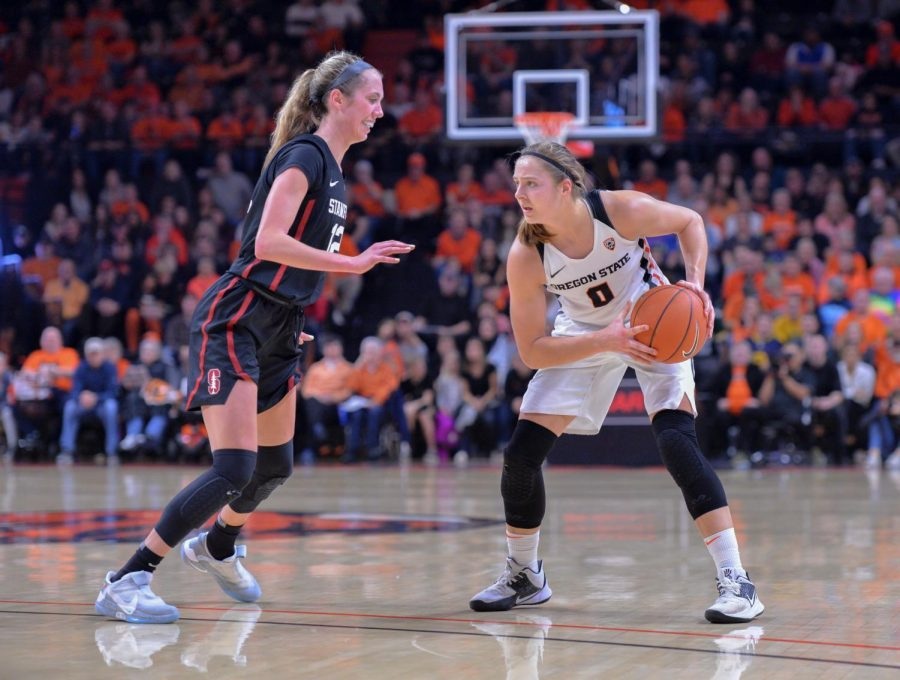 OSU senior guard Mikayla Pivec (#0) looks to find a teammate while running a play against Stanford sophomore guard Lexie Hull (#12) at Gill Coliseum on Jan. 19. The Beavers fell against Stanford during both regular season matchups and during their face off in the PAC-12 Tournament quarterfinals.