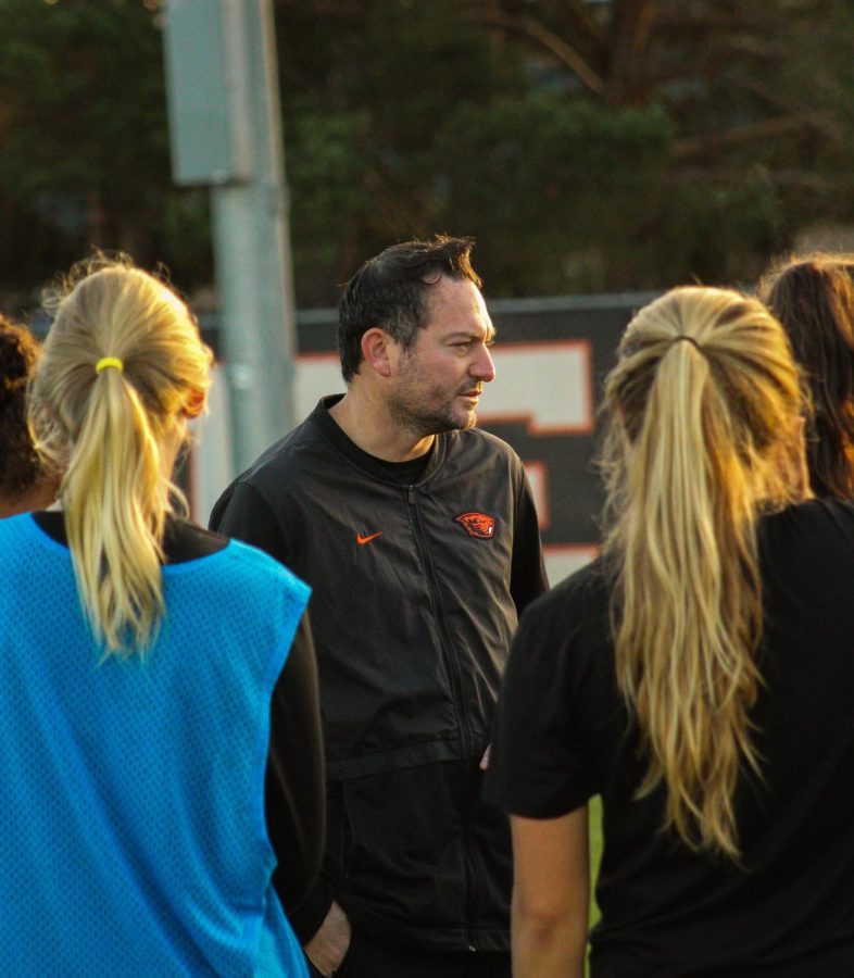 Kagan chats with players in an early morning practice Friday morning, Sept. 27.