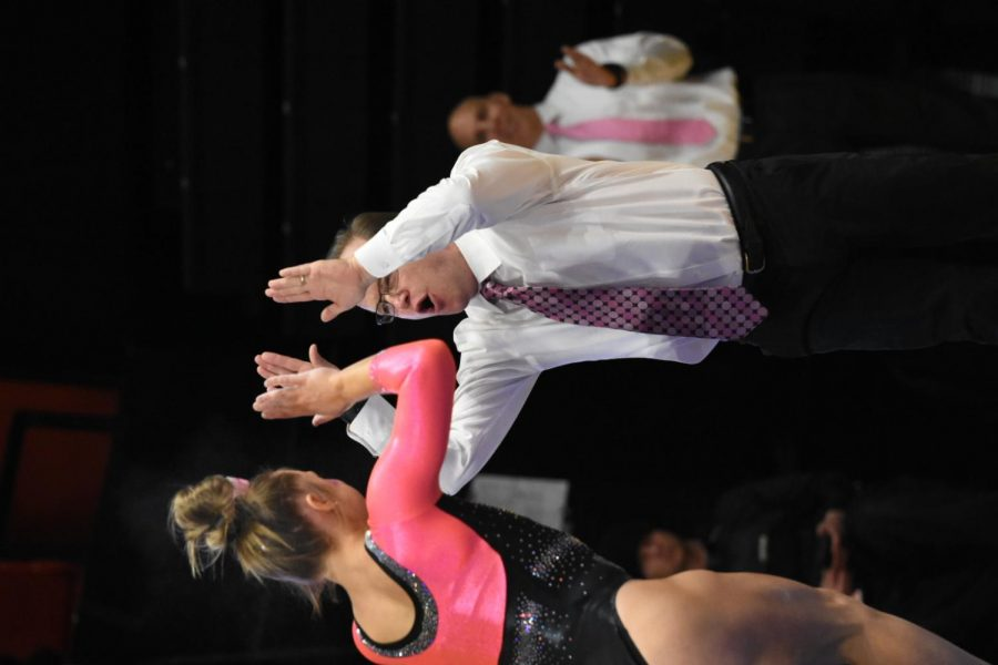 OSU+Gymnastics+interim+head+coach+Michael+Chaplin+congratulates+an+OSU+gymnast+against+Stanford+in+his+first+meet+leading+the+team+on+Feb.+2.+Chaplin%2C+husband+of+OSU+Gymnastics+head+coach+Tanya+Chaplin%2C+filled+in+while+his+wife+took+a+leave+of+absence+for+health+reasons.
