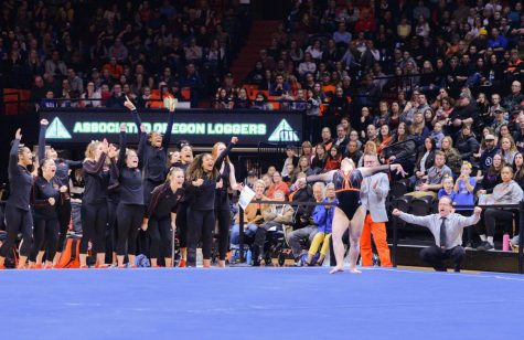 OSU sophomore Kristina Peterson performs her floor routine as the OSU gymnastics team cheers during meet versus UCLA on Feb. 29, 2020 in Gill Coliseum.