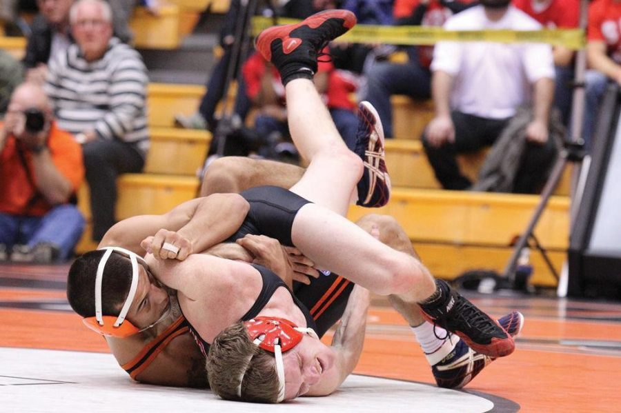 OSU freshman 125-pound Ronnie Bresser movesSOU redshirt junior Coleman Johns for the pin during the two schools' match at Gill Coliseum on Nov. 13, 2014 in Corvallis, Ore. at Gill Coliseum. Bresser defeated Coleman, his first victory of the season and the first for the Beavers on the night.