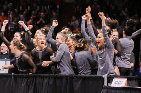 The Oregon State Gymnastics team reacting to their teams performance on the floor at the NCAA Regional Finals at Gill Coliseum on April 6, 2019. The Beavers placed 2nd in Regionals, qualifying them for the NCAA Championship Semifinals, where they ended the season ranked 3rd, causing them to fall short from the Finals.