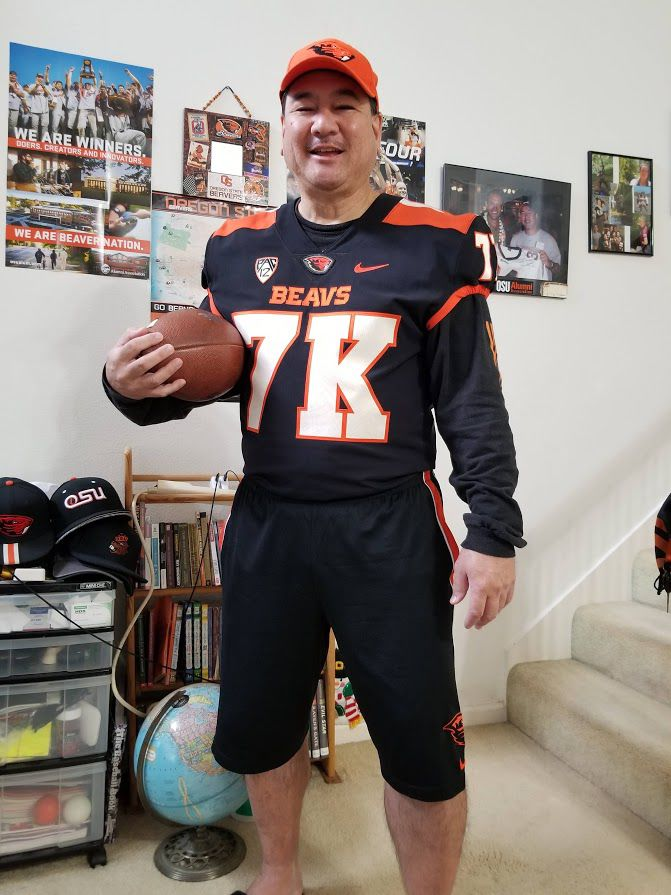 Marvin+Beaverman+Yonamine+poses+in+a+custom+OSU+Football+jersey%2C+gifted+to+him+from+the+OSU+Athletics+department%2C+to+mark+his+7%2C000th+day+in+a+row+of+wearing+OSU+gear.%C2%A0