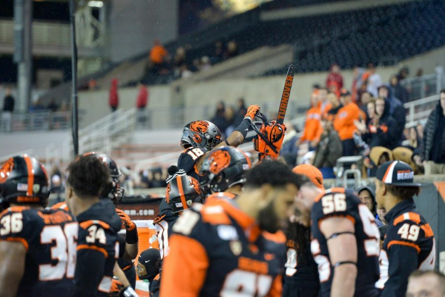 The+OSU+Football+team+holds+up+their+turnover+chainsaw+on+the+Beaver+sideline+in+a+home+game+versus+the+Utah+Utes+on+Oct.+12%2C+2019+at+Reser+Stadium.%C2%A0