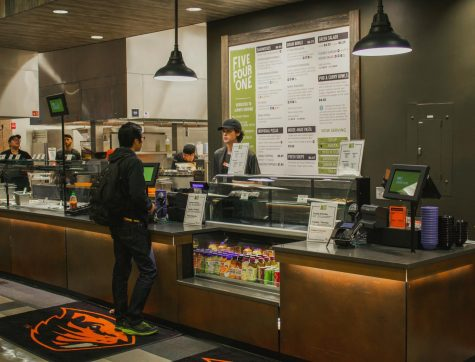 Freshman Jacob Yen orders at Five Four One at McNary, one of the dining halls on campus that offers a variety of restaurants.