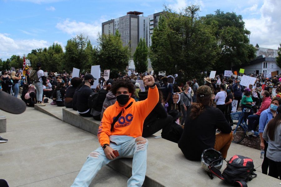 OSU Wrestler Adam Rateb raises a fist and joins others at a Black Lives Matter protest.