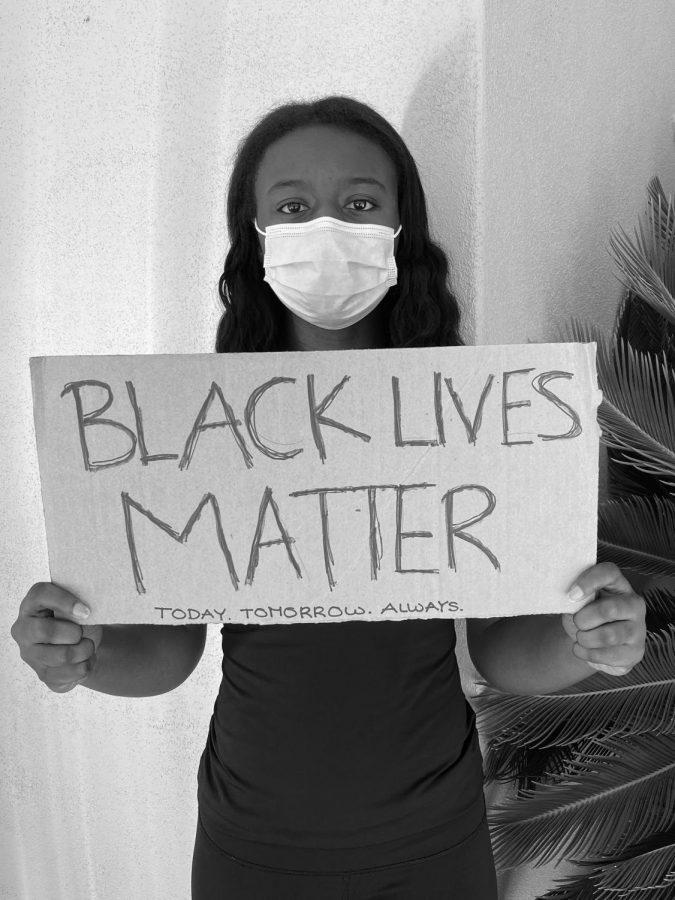 OSU Volleyballs Nya Buckner holds up a Black Lives Matter sign. Buckner has attended several protest in Arizona.